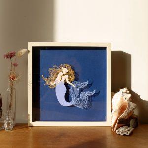 Sirène en papier découpé